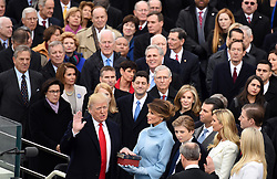 Jan. 20, 2017 - Washington, District of Columbia. U.S. - U.S. President DONALD TRUMP takes the oath of office during the presidential inauguration ceremony at the U.S. Capitol in Washington. Trump was sworn in on Friday as the 45th President of the United States. (Credit Image: © Yin Bogu/Xinhua via ZUMA Wire)