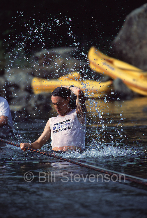 A photo of a man crossing a river in the Western States 100 ultra endurance race.