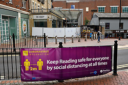 Reading Council advisory banner in front of entrance to The Oracle shopping centre, screened off in the rear of pic. Easing of Coronavirus lockdown, Reading, UK 12 June 2020