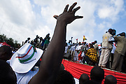 A Convention People's Party (CPP) supporter holds his hand up during a rally in Accra, Ghana on Sunday September 21, 2008.