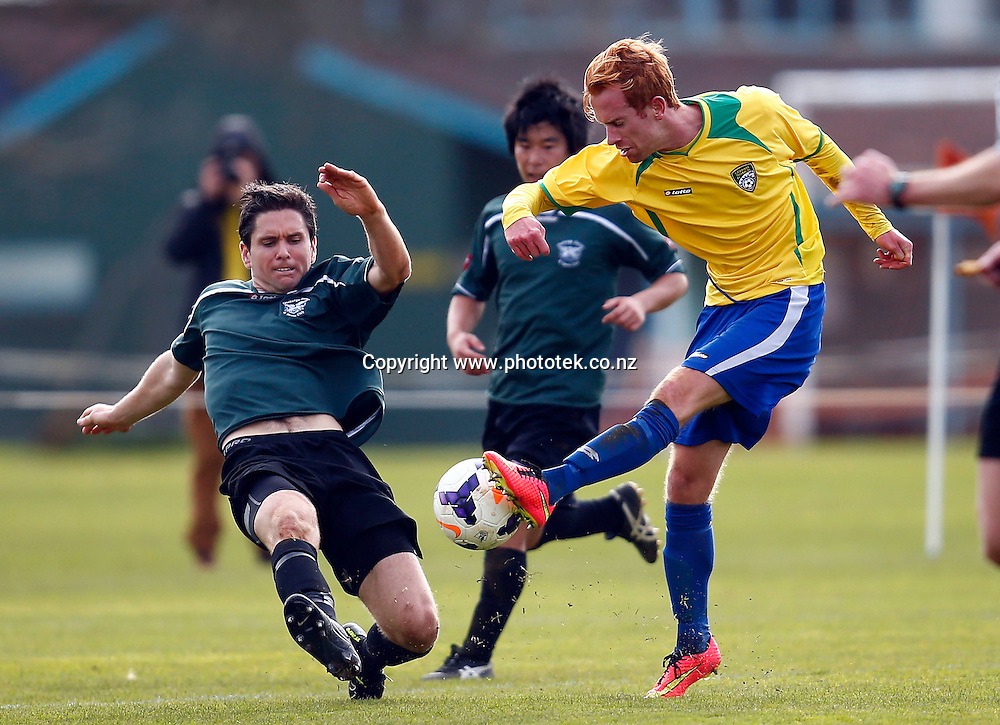 Cashmere's Aaron Clapham gets a foot to the ball. 2014 Chatham Cup Semi Finals, Onehunga Sports v Cashmere Technical, Waikaraka Park Auckland, Saturday 16th August 2014. Photo: Shane Wenzlick