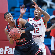 MOBILE, AL - DECEMBER 29:  Rakeem Dickerson #1 of the Arkansas State Red Wolves attempts to maneuver around Antoine Allen #12 of the South Alabama Jaguars at USA Mitchell Center on December 29, 2012 in Mobile, Alabama. Arkansas State defeated South Alabama 63-54. (Photo by Michael Chang/Getty Images) *** Local Caption *** Rakeem Dickerson;Antoine Allen