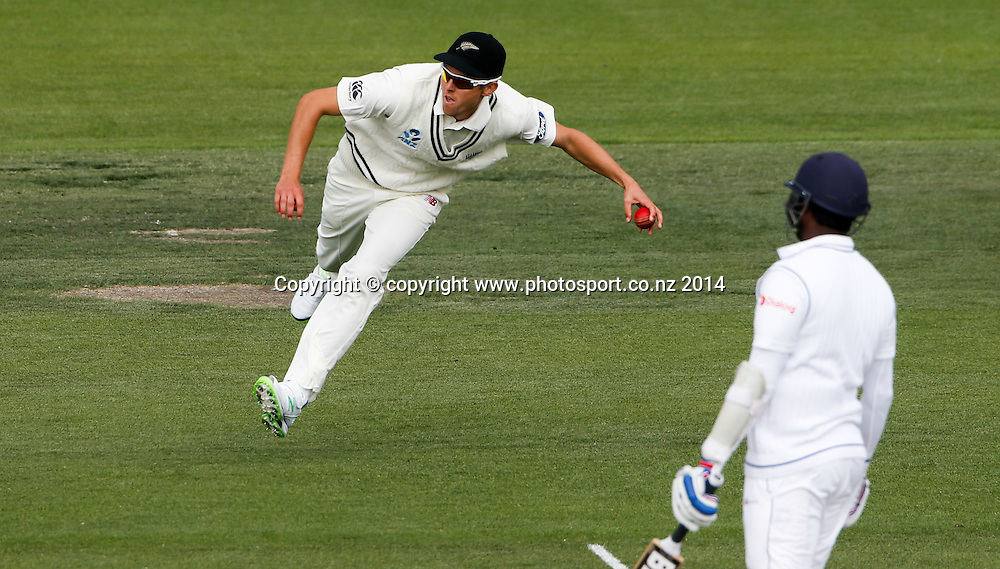 Trent Boult fields the ball. Day 3, ANZ Boxing Day Cricket Test, New Zealand Black Caps v Sri Lanka, 28 December 2014, Hagley Oval, Christchurch, New Zealand. Photo: John Cowpland / www.photosport.co.nz