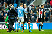 John Stones (#5) of Manchester City shakes hands with Jonjo Shelvey (#8) of Newcastle United following the Premier League match between Newcastle United and Manchester City at St. James's Park, Newcastle, England on 30 November 2019.
