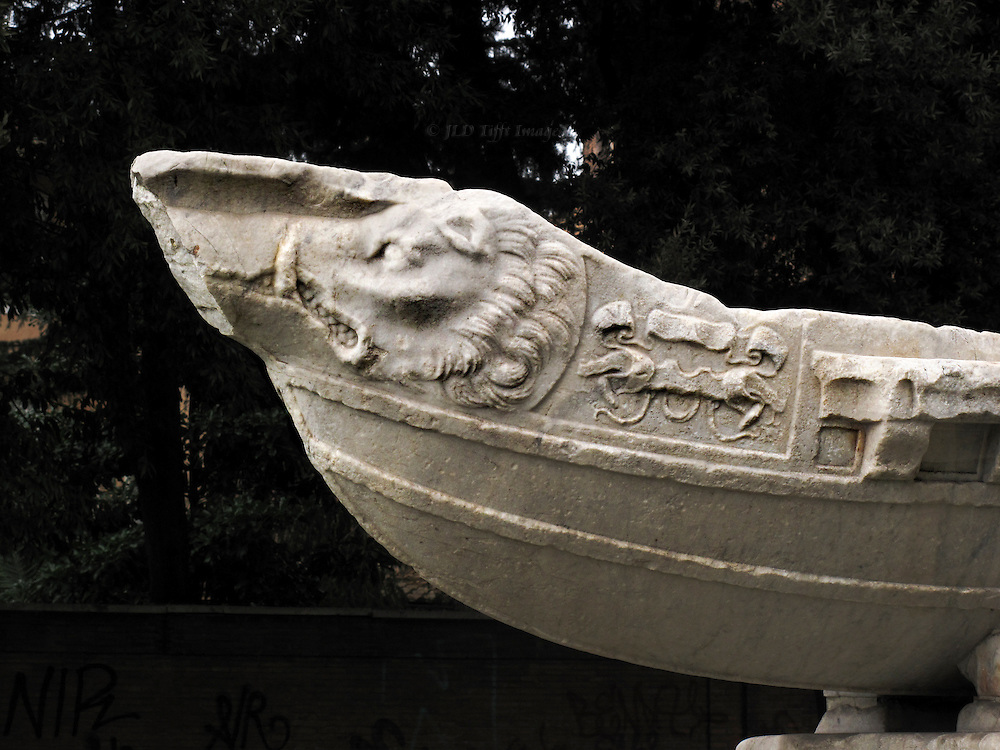 Navicella fountain in front of Santa Maria in Domnica; detail of the bow of the ancient marble gallley incorporated into the 16th century fountain.  A ferocious lion head is carved on the side