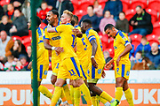 Wimbledon midfielder Mitch Pinnock (11) scores a goal and celebrates to make the score 0-1 during the EFL Sky Bet League 1 match between Doncaster Rovers and AFC Wimbledon at the Keepmoat Stadium, Doncaster, England on 17 November 2018.