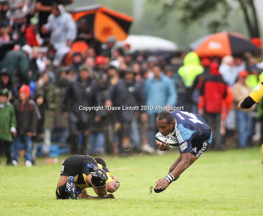 Blues captain Joe Rokocoko goes flying in a tackle.<br /> Super 14 rugby preseason match - Hurricanes v Blues at Mangatainoka RFC, Mangatainoka, Wairarapa, New Zealand on Saturday, 23 January 2010. Photo: Dave Lintott/PHOTOSPORT