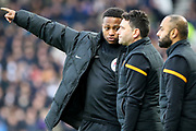 fourth official Akil Howson talks to Hull City coaching staff during the EFL Sky Bet Championship match between Derby County and Hull City at the Pride Park, Derby, England on 18 January 2020.
