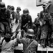 Guatemala City . Thursday September 5th 1985<br /> Small skirmishes across the city - some market sellers who decided to strike in support of the students  are arrested for their pains and unceremoniously thrown into the back of an army truck.