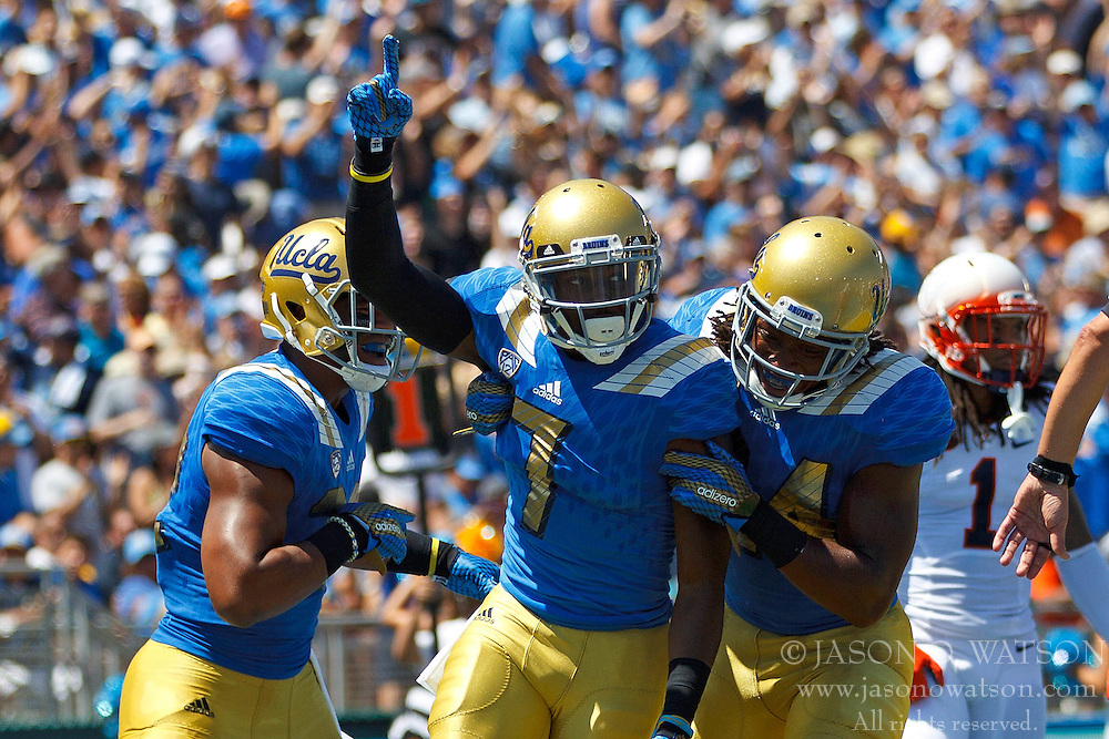 PASADENA, CA - SEPTEMBER 05:  Wide receiver Devin Fuller #7 of the UCLA Bruins celebrates after scoring a touchdown against the Virginia Cavaliers during the first quarter at the Rose Bowl on September 5, 2015 in Pasadena, California. The UCLA Bruins defeated the Virginia Cavaliers 34-16. (Photo by Jason O. Watson/Getty Images) *** Local Caption *** Devin Fuller