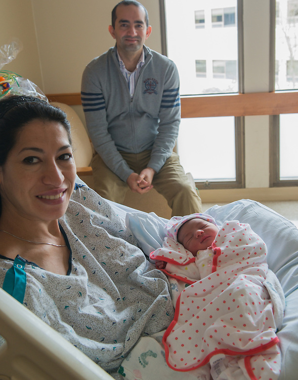 Mom, Zohra, and Dad, Saber Alaoui, sit with their new born baby girl Iman. Iman was born just after 1am at St. Mary's Hospital in Middletown.