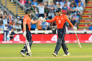 David Willey of England and Alex Hales of England touch gloves during the International T20 match between England and India at the SWALEC Stadium, Cardiff, United Kingdom on 6 July 2018. Picture by Graham Hunt.