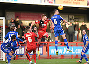 Notts County Defender Haydn Hollis heads away under pressure from Crawley Town Forward Matt Harrold during the Sky Bet League 2 match between Crawley Town and Notts County at the Checkatrade.com Stadium, Crawley, England on 16 January 2016. Photo by David Charbit.