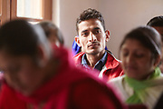 A local Chamba boy at a meeting in Bharmaur, Chamba, Himachal Pradesh, India