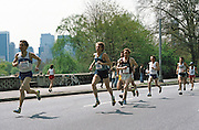 Marathon runner Bill Rodgers (1001) runs with other runners uptown through Central Park in the 1979 Trevira Twosome road race in New York circa May 1, 1979. (©Paul Anthony Spinelli)