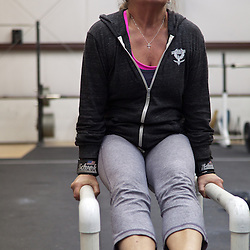 Beth Hoppe does an L-site, Crossfit image, picture, photo, photography of health, elite, exercise, training, workouts, WODs, taken at Progressive Fitness CrossFit,Colorado Springs, Colorado, USA.