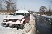 in Lancaster, New York, USA on Wednesday, November 19, 2014. Up to six feet of snow fell on the region Tuesday, stranding dozens of motorists on roadways and causing at least six deaths.