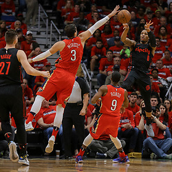 Apr 19, 2018; New Orleans, LA, USA; New Orleans Pelicans forward Nikola Mirotic (3) and guard Rajon Rondo (9) defend Portland Trail Blazers guard Damian Lillard (0) during the first quarter in game three of the first round of the 2018 NBA Playoffs at the Smoothie King Center. Mandatory Credit: Derick E. Hingle-USA TODAY Sports