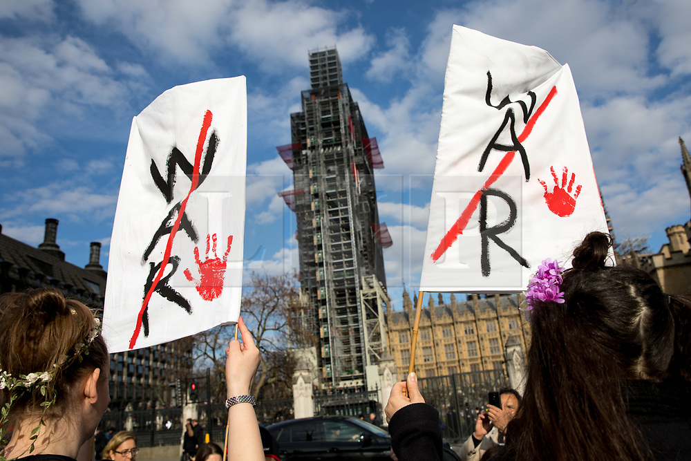 © Licensed to London News Pictures. 16/04/2018. London, UK. Demonstrators participate in the 'Don't Bomb Syria' demonstration in Parliament Square, organised by Stop the War Coalition. Photo credit : Tom Nicholson/LNP