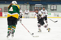 Concord's Elizabeth Donion drives a shot past Danielle Lange of Bishop Guertin during Saturday afternoon varsity hockey at Everett Arena.  (Karen Bobotas/for the Concord Monitor)