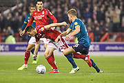 Joe Lolley of Nottingham Forest is tackled by Callum Elder of Hull City during the EFL Sky Bet Championship match between Nottingham Forest and Hull City at the City Ground, Nottingham, England on 23 October 2019.