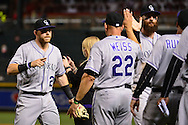 PHOENIX, AZ - APRIL 30:  Trevor Story #27 of the Colorado Rockies points to manager Walt Weiss #22 after closing out the game against the Arizona Diamondbacks at Chase Field on April 30, 2016 in Phoenix, Arizona. The Colorado Rockies won 5-2.  (Photo by Jennifer Stewart/Getty Images)