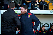 Notts County's manager Kevin Nolan and Stevenage manager Darren Sarll greet each other before the EFL Sky Bet League 2 match between Notts County and Stevenage at Meadow Lane, Nottingham, England on 24 February 2018. Picture by Nigel Cole.