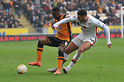 Hull City midfielder Moses Odubajo (2) and Milton Keynes Dons forward Daniel Powell(17) during the Sky Bet Championship match between Hull City and Milton Keynes Dons at the KC Stadium, Kingston upon Hull, England on 12 March 2016. Photo by Ian Lyall.
