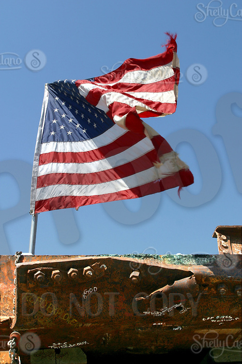 Sep 10, 2002; Yorba Linda, California, USA; American Flag waves over an exhibit of 9/11 wreckage from the World Trade Center at the Richard Nixon Library &amp; Birthplace. <br />