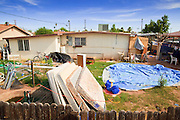 "15 AUGUST 2011 - PHOENIX, AZ: The backyard of the home that Ame Deal, a 10 year old girl allegedly murdered by her family when she was locked in a footlocker, lived in in Phoenix, AZ. Phoenix police homicide investigators have arrested four people in connection to the death of the 10-year-old girl whose body was found inside a box on July 1, 2011. Police originally thought a game of hide-and-seek had turned deadly but now say family members fabricated the story. During the initial investigation, the family had told police that Ame Lynn Deal and other children were playing hide-and-seek and they believed that Ame must have climbed into the storage box to hide and had accidentally suffocated. According to Sgt. Trent Crump with the Phoenix Police Department, investigators determined that Ame was forced into the footlocker-type box as punishment for stealing a Popsicle from the refrigerator. The box was padlocked and Ame was left in it overnight at her home near 35th Avenue and Broadway Road. She was found dead the following morning. Crump said Ame was forced to do backbends for several hours prior to dragging the chest inside the house herself. He described the box as 31.5 inches in length, 14 inches wide and 12.25 inches deep. At the time of her death, Ame was 4 feet 2 inches tall and weighed 60 pounds. Ame's family members regularly locked her in the box as discipline for poor behavior, according to Crump. There were allegations that she was fed hot sauce, deprived of food and beaten with a board over the past few months. He said when Ame wouldn't pick up dog feces, it was rubbed on her and she was forced to eat it. ""This child died at the hands of those who were supposed to love and care for her... this case has turned the stomachs of some of our most seasoned detectives,"" Crump said. John Allen and his wife, Samantha Allen, both 23, confessed to placing and padlocking Ame in the box on July 12. They were left in charge of Ame that night. They were charged with firs"