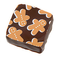 orange and white gingerbread man on jacques torres seasonal chocolate bon bon