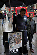 Londoners pass-by the London newspaper Evening Standard's latest headline about ex-Russian spy Sergei Skripal's suspected poisoning by Russia in southern England, on 6th March 2018, in the capital's financial district, the City of London, England. As both Skripal and a woman believed to be his daughter Ylulia remain in a critical condition at Salisbury hospital where he was taken ill on Sunday 4th, British Counter Terrorism Police have taken over the investigation from the local Wiltshire force. The British press have been quick in blaming President Putin's involvement just weeks before his Presidential re-election.