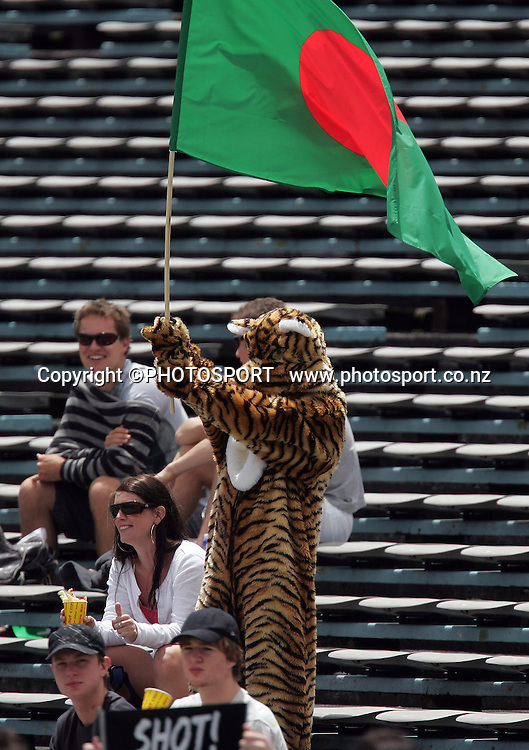 A Bangladesh supporter dressed as a tiger cheers their team. New Zealand Black Caps v Bangladesh, 1st One Day International, Eden Park, Auckland, New Zealand. Wednesday 26th December 2007. Photo : Chris Skelton/PHOTOSPORT