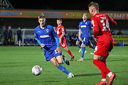 AFC Wimbledon attacker Marcus Forss (15) battles for possession with Leyton Orient defender Myles Judd (14) during the Leasing.com EFL Trophy match between AFC Wimbledon and Leyton Orient at the Cherry Red Records Stadium, Kingston, England on 8 October 2019.