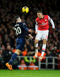 Arsenal Defender Kieran Gibbs (ENG) beats Man Utd Forward Robin van Persie (NED) to the ball - Photo mandatory by-line: Rogan Thomson/JMP - 07966 386802 - 12/02/14 - SPORT - FOOTBALL - Emirates Stadium, London - Arsenal v Manchester United - Barclays Premier League.