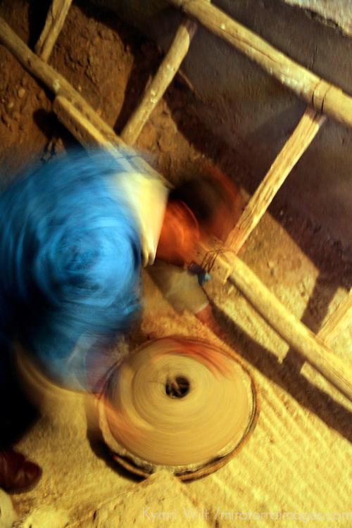 Africa, Morocco, Ouarzazate. Berber spinning clay in home.
