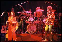 Yes performing at the New Haven Coliseum on 9 August 1977. L-R: Jon Anderson, Alan White, Chris Squire. Credit Photograph: James R Anderson, New Haven CT