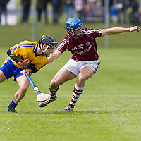 Clare's Cathal (Tots) O'Connell holds back Galway's Johnny Coen
