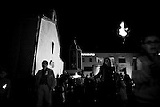 """Pignola/Basilicata/Italy  17-05-08 - The traditional procession of the """"Uglia"""". For the celebrations for the ?Madonna del Pantano?, a religious procession called ?della Uglia? takes place in the centre of Pignola. A little fabric throne having the shape of a steeple, with a painted image of the Madonna, is taken in procession around the village by a group of young people and followed by a band of locals. The Uglia bearers meet on their way obstacles in the narrow lanes, such as fires of brooms, called ?fanoia?. This tradition probably represents the fight between Good and Evil or maybe it is a way for making the Madonna spend more time in the quarter, so that people can ask for her protection. The Uglia bearers stage several attempts to jump into the flames, taking some Dutch courage in the form of wine. When the flames die out, the procession passes through the embers with a sudden jump and keeps on going until it meets further fires..."""