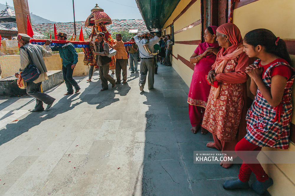 People showing respect to the Deity as he enters Raghunath Temple on Kullu Dussehra. Kullu Dussehra is the Dussehra festival observed in the month of October in Himachal Pradesh state in northern India. It is celebrated in the Dhalpur maidan in the Kullu valley. Dussehra at Kullu commences on the tenth day of the rising moon, i.e. on 'Vijay Dashmi' day itself and continues for seven days. Its history dates back to the 17th century when local King Jagat Singh installed an idol of Raghunath on his throne as a mark of penance. After this, god Raghunath was declared as the ruling deity of the Valley.