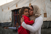 Mahmoud's wife Sana and their daughter Gena outside their home in Baharka camp.