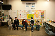 Nuclear Exclusion zone.    In Minami Soma town office  Residents wait for assistance.. Many delivery drivers are refusing to deliver goods to areas in Fukushima Prefecture even those towns outside  the Exclusion Zone.