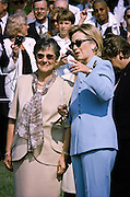 First lady Hillary Rodham Clinton talks with Hungarian first lady Zsuzsanna Goncz (L) during an arrival ceremony on the South Lawn of the White House for Hungarian President Arpad Goncz June 8, 1999 in Washington, DC.