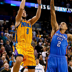 December 10, 2010; New Orleans, LA, USA; New Orleans Hornets shooting guard Marco Belinelli (8) shoots over Oklahoma City Thunder guard Thabo Sefolosha (2) during the second half at the New Orleans Arena.  The Thunder defeated the Hornets 97-92. Mandatory Credit: Derick E. Hingle-US PRESSWIRE