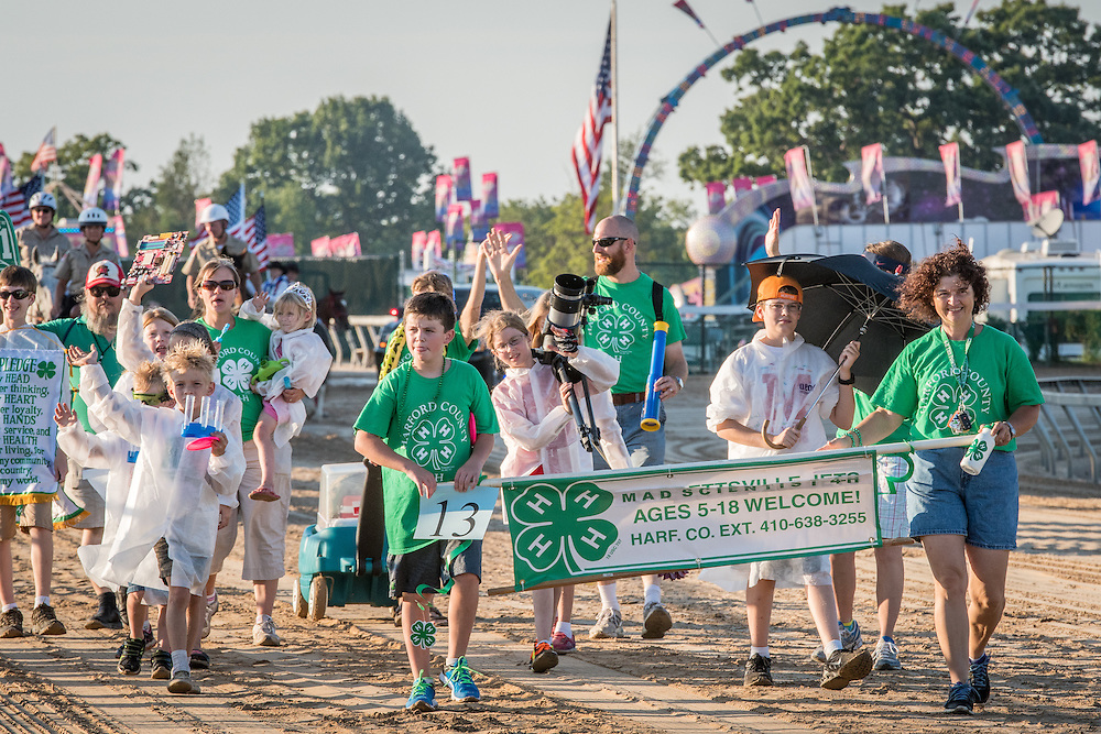 Timonium, Maryland - Young children and adults parade through the fair while holding a banner at the 2016 Maryland State Fair.