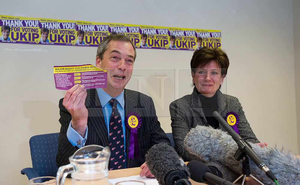 © London News Pictures. 01/03/2013 . Eastleigh, UK.  UKIP (UK INdependence Part) leader NIGEL FARAGE (Left) holding up a Conservative PArt leaflet using the UKIP party colours during a media conference with UKIP candidate, DIANE JAMES after the party came second in the Eastleigh by-election. Photo credit : Ben Cawthra/LNP