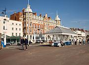 People walking along the promenade at Weymouth, Dorset, England