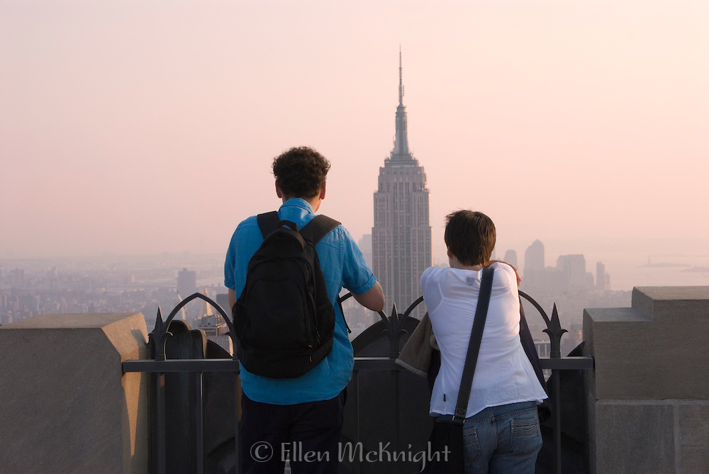 Tourists Viewing the Empire State Building from the top of Rockefeller Center