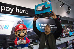 © licensed to London News Pictures. London, UK 29/11/2012. The first Nintendo Wii U in London has its owner as Nintendo launching its latest gaming console, Wii U at HMV Store in Oxford Street, London. Photo credit: Tolga Akmen/LNP