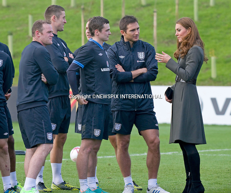 """CATHERINE, DUCHESS OF CAMBRIDGE.chats to members of the English Footbal Squad including Frank Lampard and Wayne Rooney..Katew and Prince William attended the opening of St. George's Park, the Football Association's National Football Centre, Burton-Upon-Trent..Their Royal Highnesses were given a tour of the main facilities on the 330-acre site and also met England Manager Roy Hodgson and his squad as they trained at St. George's Park for the first time_09/10/2012.Mandatory credit photo: ©Dias/NEWSPIX INTERNATIONAL..(Failure to credit will incur a surcharge of 100% of reproduction fees)..                **ALL FEES PAYABLE TO: """"NEWSPIX INTERNATIONAL""""**..IMMEDIATE CONFIRMATION OF USAGE REQUIRED:.DiasImages, 31a Chinnery Hill, Bishop's Stortford, ENGLAND CM23 3PS.Tel:+441279 324672  ; Fax: +441279656877.Mobile:  07775681153.e-mail: info@newspixinternational.co.uk"""